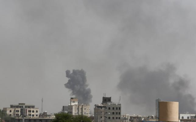 Smoke billows from the site of Saudi-led air strikes on al-Dailami air base in Sanaa