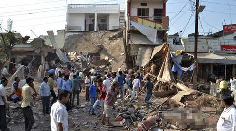 People stand near the site of an explosion in Jhabua district at Madhya Pradesh