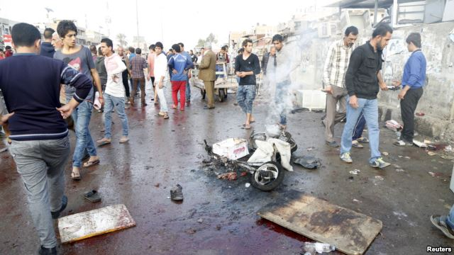 sadr-city-baghdad-market-bombings-kill-twenty-four