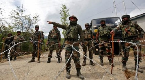 Indian army soldiers stand guard inside their army base after it was attacked by suspected separatist militants in Panzgam in Kashmir's Kupwara district