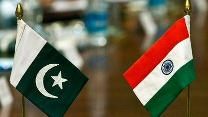 Pakistani (L) and Indian flags stand on a table during an Indian-Pakistan meeting on the Sir Creek region in New Delhi on June 18, 2012. Pakistan and India started two-day talks in New Delhi to resolve their maritime boundary dispute in the Sir Creek region. Sir Creek, which opens up into the Arabian Sea dividing the Kutch region of the Indian state of Gujarat with the Sindh province of Pakistan, is a 96-km strip of water that is disputed between India and Pakistan. AFP PHOTO / Prakash SINGH