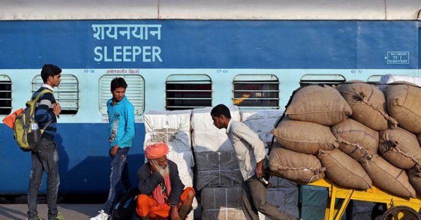 People wait on a platform as a train is unloaded in a railway station in New Delhi, India February 1, 2017. REUTERS/Cathal McNaughton